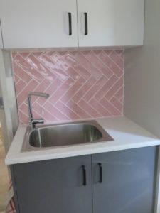 pink subway tile laundry